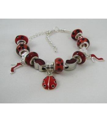 Bracelet argenté perles Coccinelle rouge