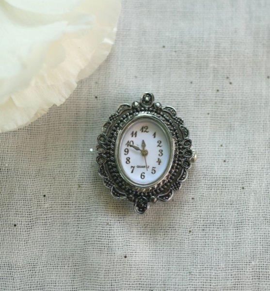 Cadran de montre argenté ovale