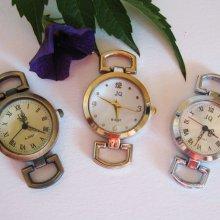 3 cadrans  montre : argenté, bronze, doré